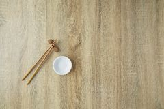 Chopsticks and white bowl. On wooden table background.Flat lay,Copy space. Design, Sunlight at noon, Japanese style royalty free stock photography