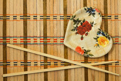 Chopsticks. On a wicker mat stock photography