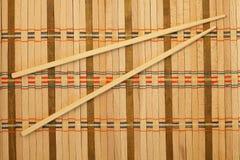 Chopsticks. On a wicker mat Royalty Free Stock Photo