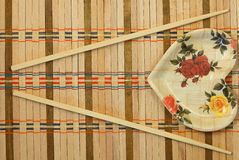 Chopsticks. On a wicker mat royalty free stock photos