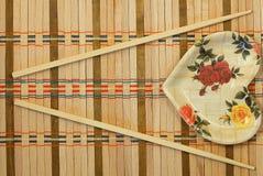 Chopsticks. On a wicker mat Royalty Free Stock Photos