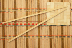 Chopsticks. On a wicker mat stock image
