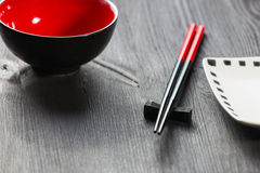 Chopsticks on wooden background Stock Images