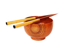 Chopsticks with wooden bowl isolated on white Royalty Free Stock Photo
