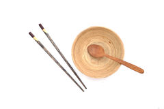 Chopsticks with wooden bowl isolated Stock Photography