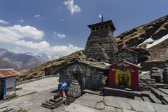 CHOPTA, GARHWAL, UTTARAKHAND, INDIA, May 2013, Devotee at famous Tungnath temple the highest Shiva temple in the world stock photography