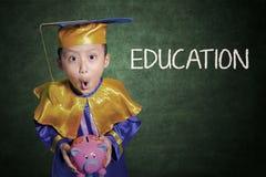Choque del muchacho en tarifas de la educación Foto de archivo libre de regalías