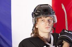 chorągwiany France hokeja lód nad graczem Zdjęcia Stock