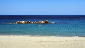 Chora Beach, Skyros Greek Island, Greece. The main town beach, or Chora Beach, on Skyros, a Sporades Greek Island, with clear blue sky, rock formations in clear Royalty Free Stock Images