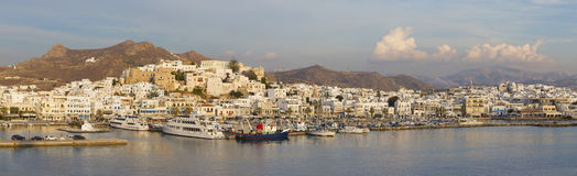 Chora - The panorama of town Chora (Hora) on the Naxos island at evening light in the Aegean Sea. Stock Photos