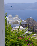 Chora village on Milos Island. Scenic view looking down on Chora village with flowers in foreground, Milos island, Cyclades, Greece Stock Image