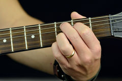 Chord on the guitar. Hand, hold a chord on the guitar fretboard Stock Photography