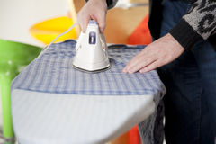 Chore. Housework - a man is ironing his shirt royalty free stock images