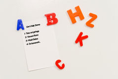Daily Chore List. On Fridge With Alphabet Magnets Stock Photography