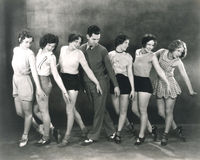 Choreographer rehearsing with dancers Stock Photo