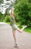 Choreographic dance in the park with ice cream in hand, the joy of the coming summer and holidays Stock Photos