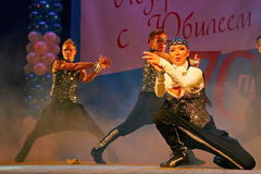 Choreographic miniature in the style of 90-ies - dancers performing troupe of the St. Petersburg music hall. Stock Photos