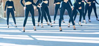 Choreography of girls dancing with black mayas and heels royalty free stock photography