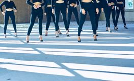 Choreography of girls dancing with black mayas and heels royalty free stock photo