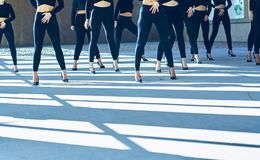 Choreography of girls dancing with black mayas and heels royalty free stock photos