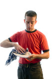 Daily Chores. A man drying dishes as part of his daily chores Stock Photo