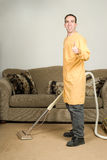 Daily Chores. A happy worker cleaning the carpets and giving the camera a thumbs up Stock Photography