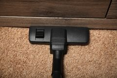 Chores on carpet, electric vacuum cleaner stock photos