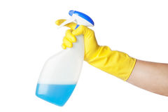 Chores - hand in yellow glove and spray. Royalty Free Stock Photography
