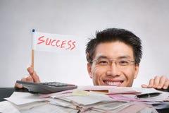 chorągwiany mienia mężczyzna sukces Fotografia Stock