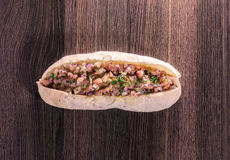 Choripan with chopped tomato capture two. Delicious meal of sausage and baguette bread with chopped tomato Royalty Free Stock Photo