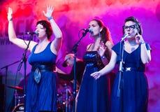 choristerskvinnlig som sjunger tre Royaltyfria Foton