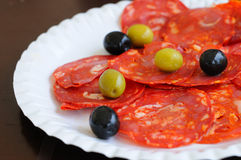 Chorizo. And olives on white plate Stock Photography