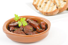 Chorizo al Vino. (Spicy sausage cooked in red wine). Traditional Spanish tapas dish Stock Photography