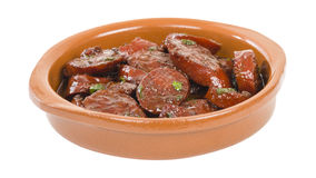 Chorizo al Vino. (Spicy sausage cooked in red wine). Traditional Spanish tapas dish Royalty Free Stock Image