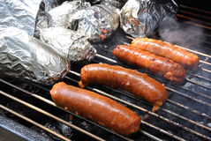 Barbecue. Image of some chorizos and potatoes on a barbecue royalty free stock photos