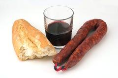 Chorizo, brood en wijn stock fotografie