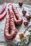 Chorizo with cherry tomatoes. On the wooden board Royalty Free Stock Image