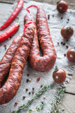 Chorizo with cherry tomatoes. On the wooden board Royalty Free Stock Photography
