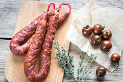 Chorizo with cherry tomatoes Stock Photos