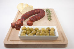 Chorizo on cutting board Royalty Free Stock Photo