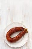 Chorizo en plato fotos de archivo