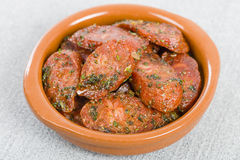 Chorizo & Herbs. Chorizo & Herbs - Fried chorizo with herbs served in a cazuela Royalty Free Stock Photo
