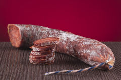 Chorizo iberico in a table. On a red background Stock Photo