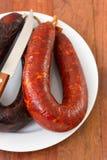 Chorizo with knife Royalty Free Stock Images