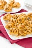 Chorizo Lattice Rolls. Spanish chorizo and red pepper wrapped in pastry Stock Photos