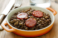 Chorizo with lentil on dish Royalty Free Stock Images