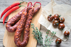 Chorizo med körsbärsröda tomater Royaltyfri Fotografi