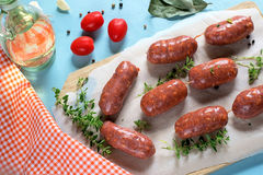 Chorizo with olive oil, bay leaves and tomatoes. Chorizo sausages with bay leaves, pepper and tomatoes royalty free stock image