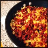 Chorizo and Onions in Saute Pan Royalty Free Stock Images
