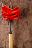 Chorizo pamplona salame on meat fork and old wood Stock Image